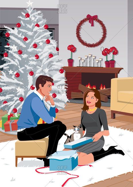 Couple exchanging presents in living room on shag rug