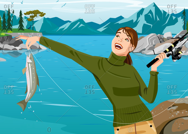 Woman in sweater holding fishing pole and fish in front of lake and mountains