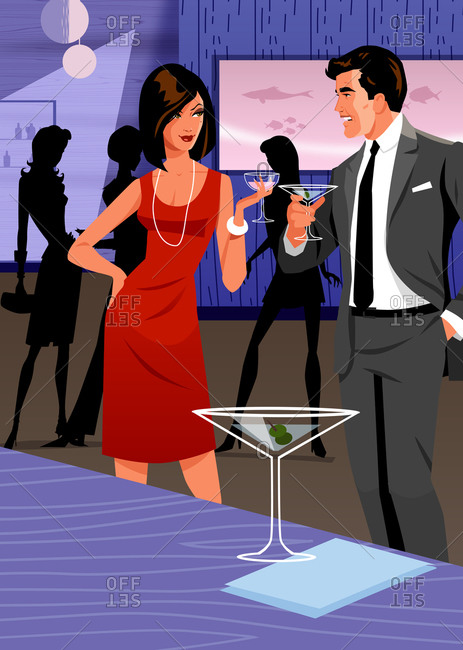 Couple with drinks talking in retro martini bar