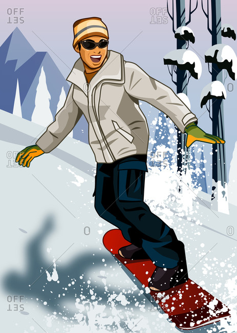 Young man going down hill with snowboard with mountains in background