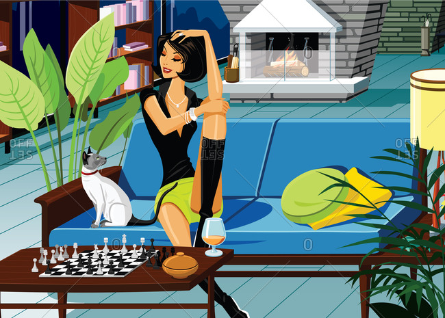 Woman on couch next to chess set looking at cat