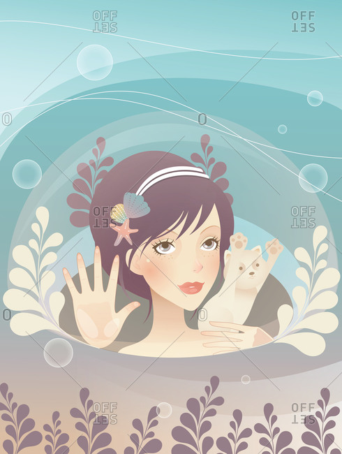 A young woman and her cat watching the sea through a bubble