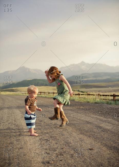 Kids dancing on dirt road