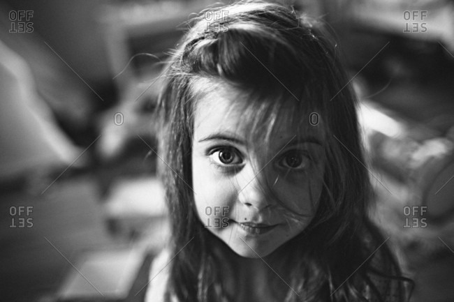 little girl looking up into camera