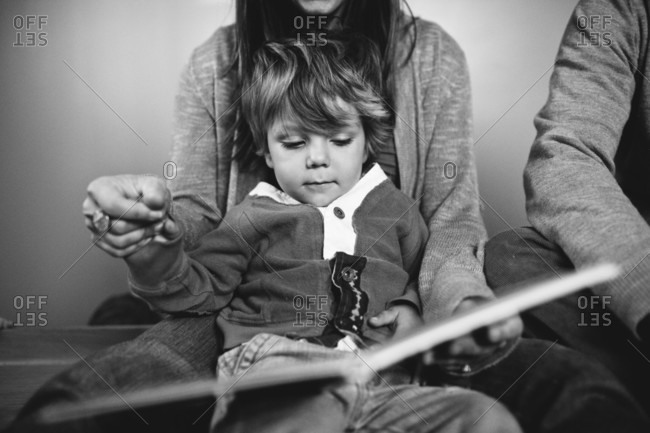 Mom reading book to little boy