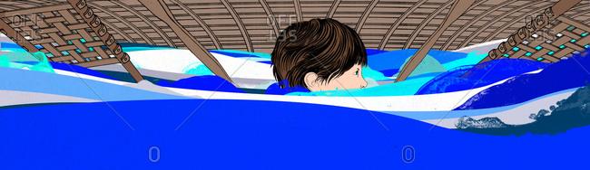 A boy swimming under an upside down canoe