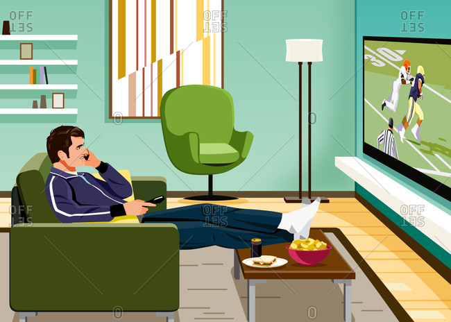 Man watching big screen TV sitting on couch