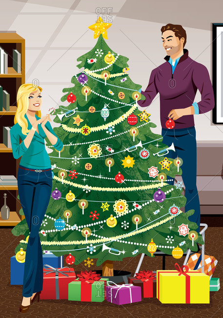 Male and female couple decorating Christmas tree with presents underneath