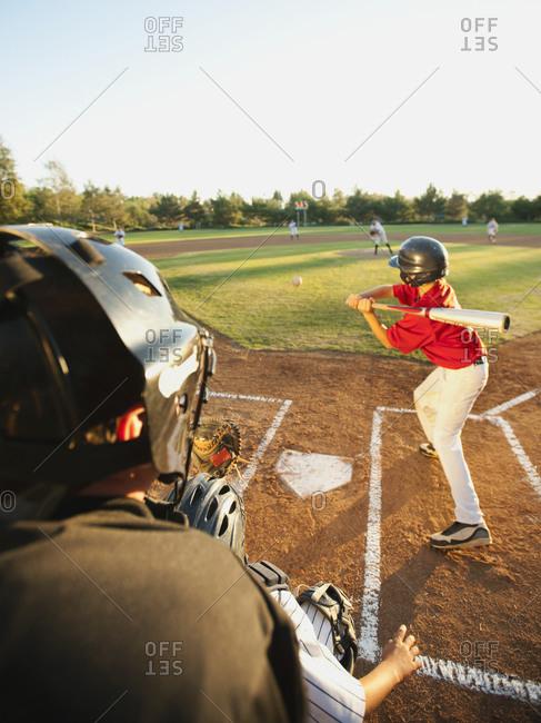 USA, California, Ladera Ranch, boys (10-11) playing baseball