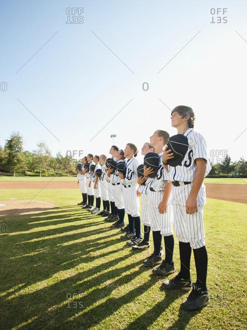 USA, California, Ladera Ranch, baseball players (aged 10-11) on field