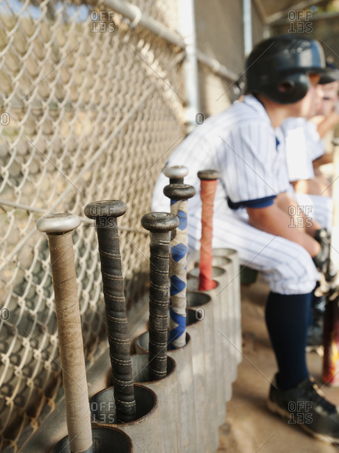 USA, California, Ladera Ranch, Boys (10-11) from baseball sitting on dugout