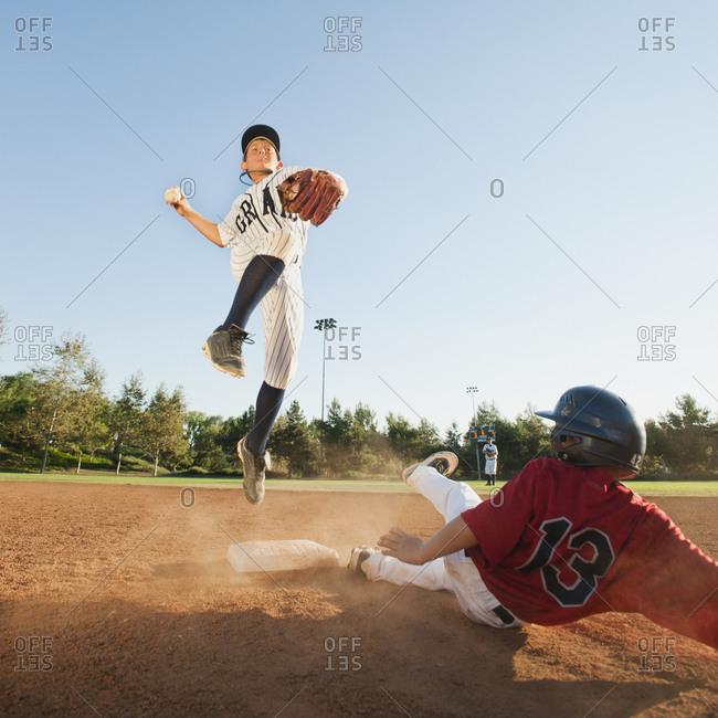 Boys (10-11) playing baseball