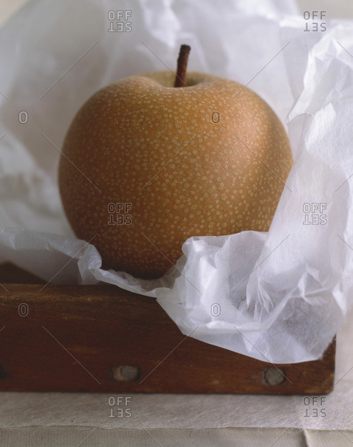 One asian pear in wax paper.