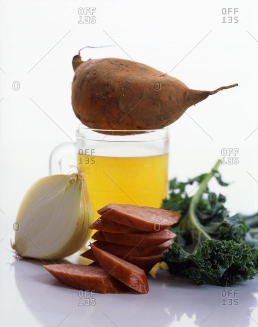 Raw ingredients: onion, sausage, kale and sweet potato.