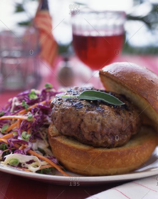 Fresh hamburger with mixed salad.