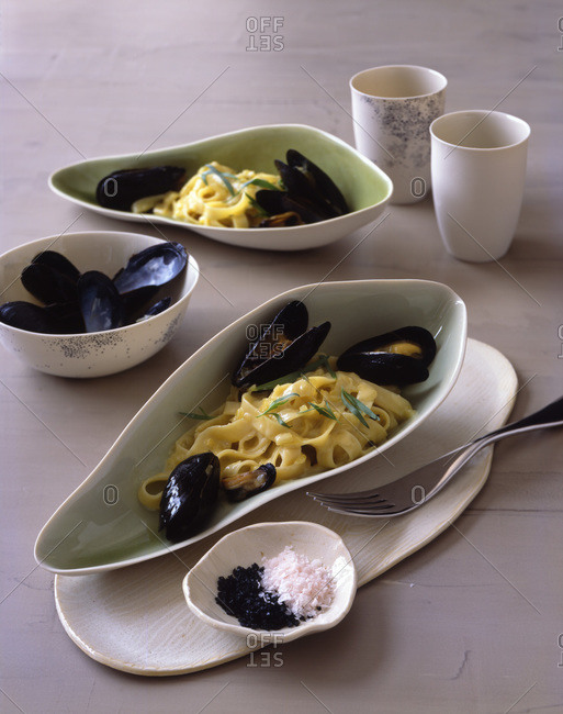 Seasoned pappardelle with mussels.