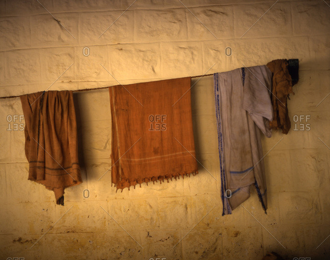 Ragged clothes hanging on a clothesline.