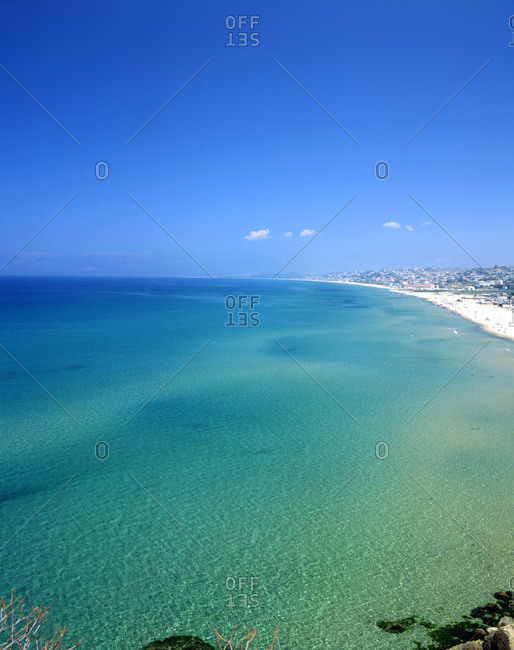 A picturesque aqua seascape and blue sky.