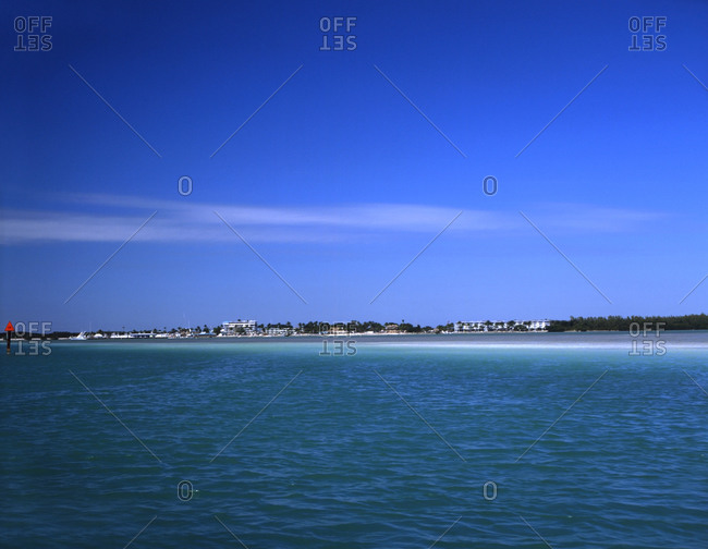 A picturesque seascape and blue sky.