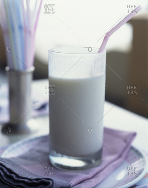Yogurt-based salty lassi with a straw.