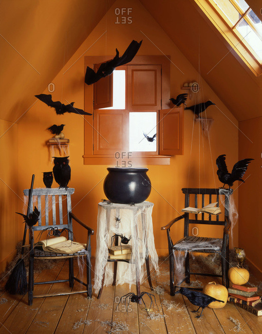 Scary Halloween interior decoration with spider web and witch caldron