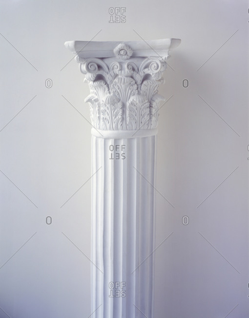 Corinthian column in white.