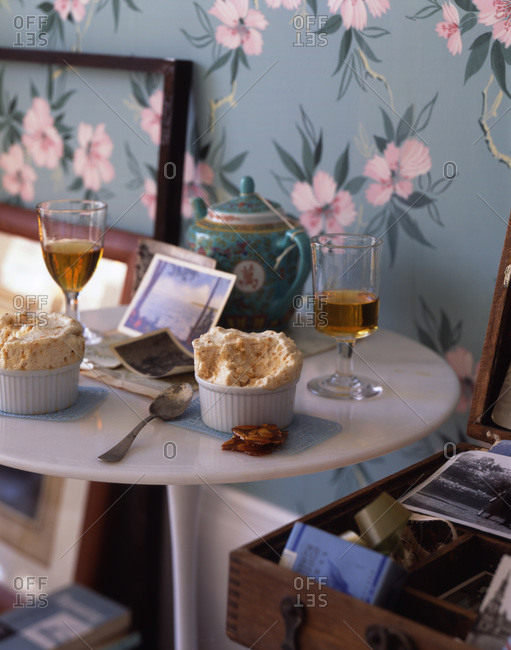 Room interior with tea, souffles and old photos.
