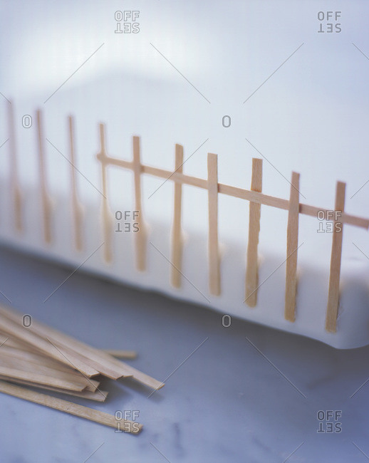 Close up of a miniature wooden fence