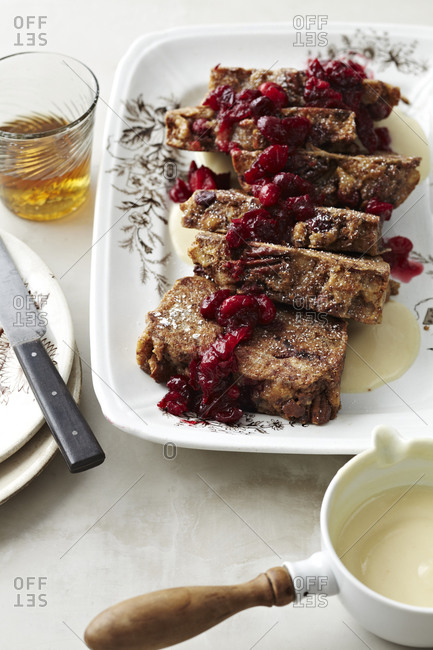 Fruit loaf slices with fruits and vanilla sauce