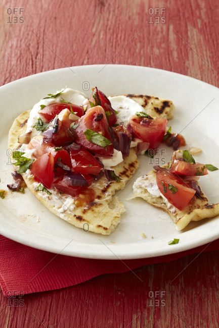 Close up of tortilla with salsa and cream
