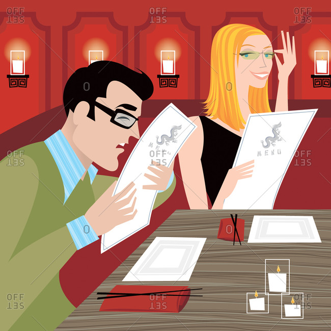 Couple with glasses sitting in a Chinese restaurant and reading the menu