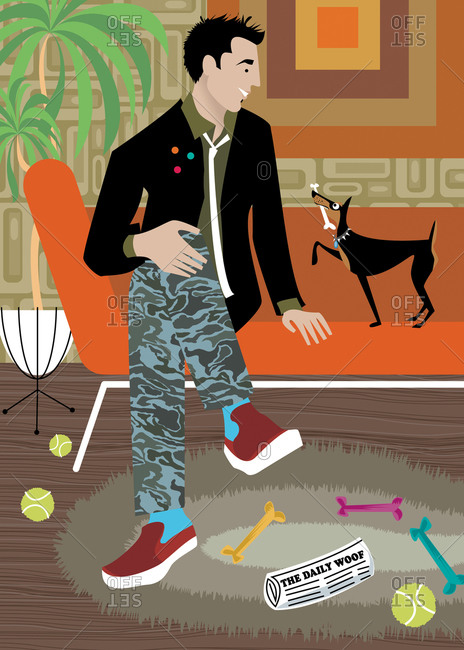 Hip fashionable man sitting in modern living room with small dog