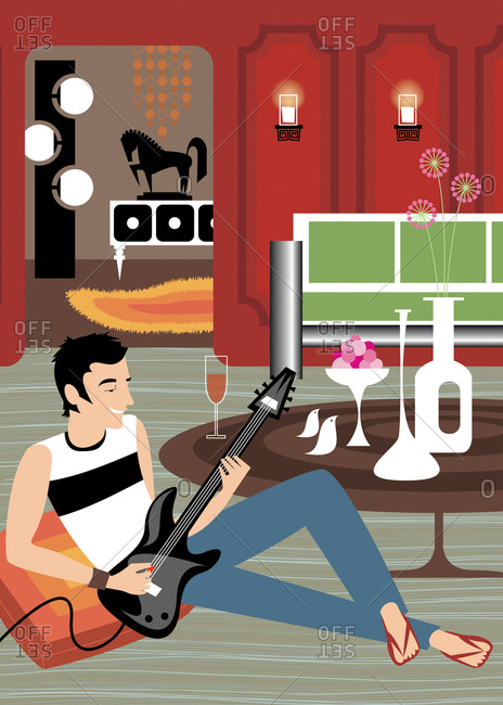 Hipster man playing electric guitar in eclectic modern living room