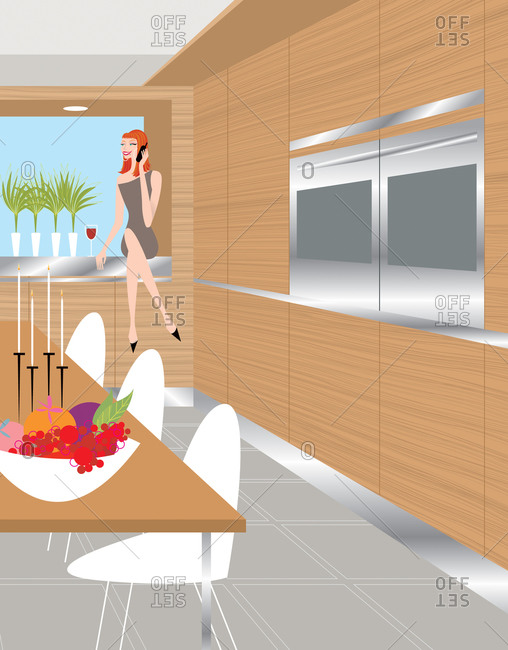 Woman sitting on counter and chatting on phone in modern kitchen