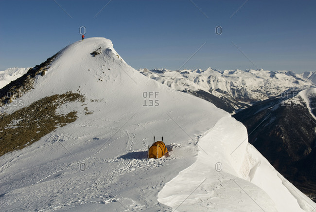 A man camping on a high ridge line in the winter, San Juan National Forest, Colorado