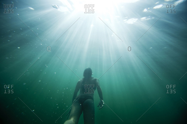 Female enjoys diving underwater in Idaho