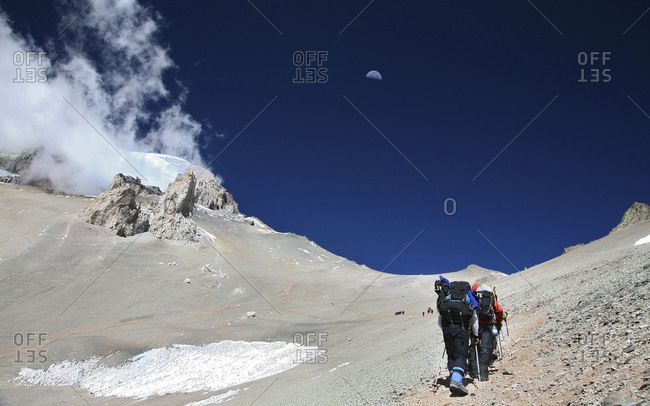 Guided mountaineering team making a carry up to High Camp on Aconcagua, Andes Mountains, Argentina