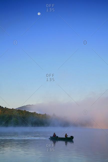 Canoeing in morning fog on Lake Eaton, Adirondack Park, USA