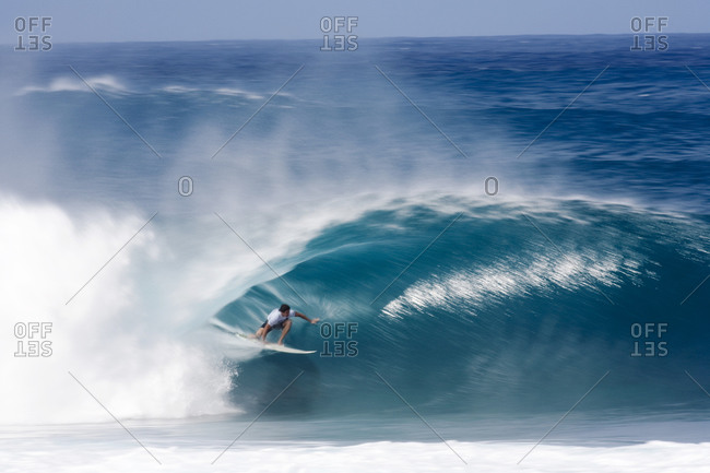 A surfer inside a perfectly tubing wav at Pipeline