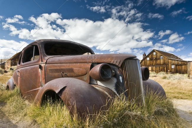 An old abandoned car rusts away in the ghost town of Bodie, CA