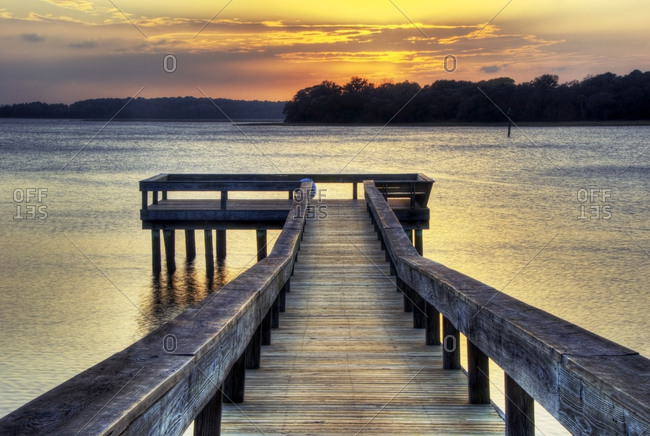A pier at sunset on the Intracoastal Waterway on Hilton Head Island, South Carolina