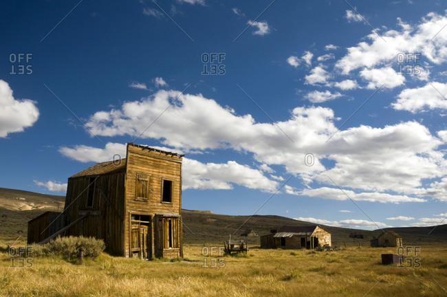 Old rundown buildings in afternoon light in the ghost town of Bodie, CA