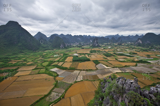 Patchwork farms stretch between the Karst mountains of Yanghsuo County, China