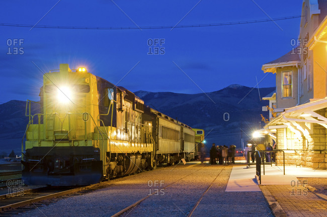People load onto a diesel train at the Nevada Northern Railway at dusk in Ely, Nevada