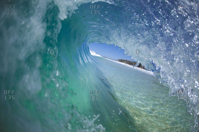 A water view of a perfectly barreling wave in Hawaii