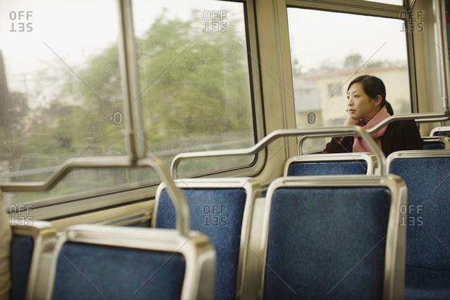 Teenage girl riding bus