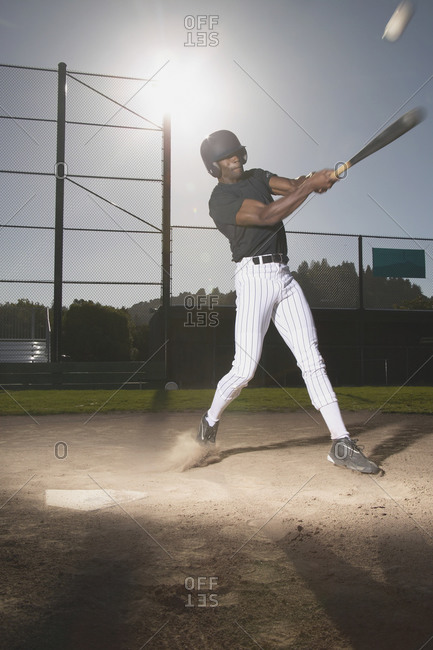 Man swinging bat in baseball game