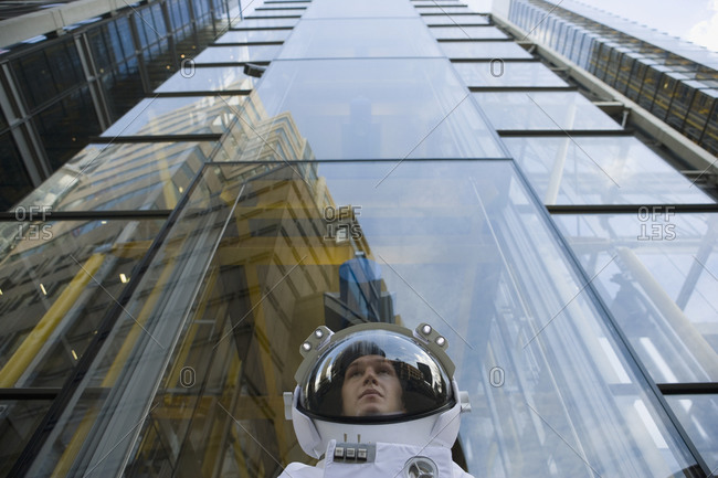 Low angle view of an astronaut in urban setting