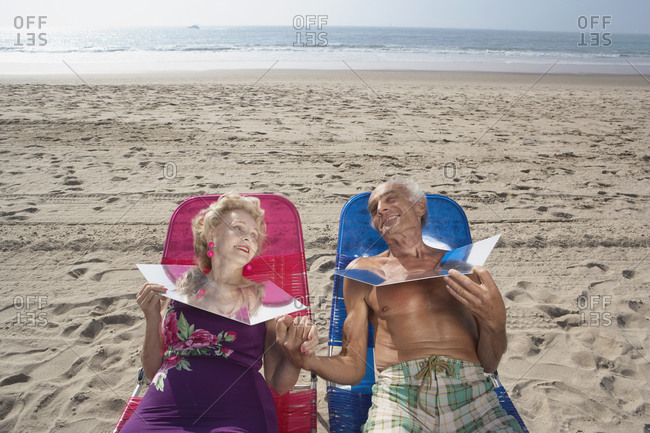 Senior couple sunning themselves at the beach