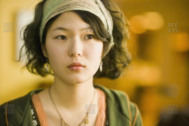 Asian woman wearing headband - Offset